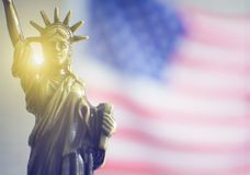 Statue of Liberty with the light behind royalty free stock photo