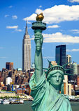 The Statue of Liberty and Manhattan Royalty Free Stock Photos