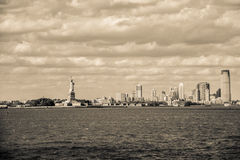 The Statue of Liberty and Manhattan, New York City Stock Photography
