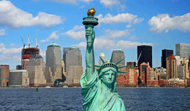 The Statue of Liberty and Manhattan Skyline Stock Image