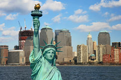 The Statue of Liberty and Manhattan Skyline Royalty Free Stock Photo