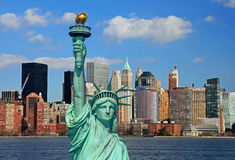 The Statue of Liberty and Manhattan Skyline Stock Photo