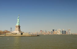 Statue of Liberty and Manhattan skyline Royalty Free Stock Photography