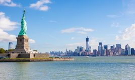 Statue of Liberty and the Manhattan Skyline in New York City royalty free stock photos