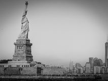 Statue of Liberty and Manhattan. View from a boat Stock Image