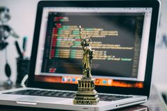 Statue of Liberty Miniature on Macbook Pro Stock Images