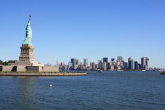 The statue of liberty and new york. From the boat, the statue of liberty and new york in the background royalty free stock photo