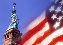 The Statue of Liberty - New York. The Statue of Liberty and the flag of the United States of America Stock Photo