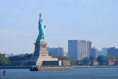 Statue of Liberty, New York City. New York City Statue of Liberty with skyscrapers in Manhattan Stock Photo