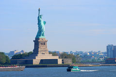 Statue of Liberty, New York City. New York City Statue of Liberty with boat in Manhattan over Hudson River Royalty Free Stock Image