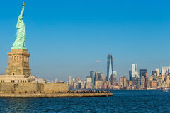 Statue of Liberty and New York City. Statue of Liberty virtually overlooking Lower Manhattan and New York City Stock Images
