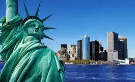 Statue of liberty, new york city. Statue of liberty and new york city in the background royalty free stock photo