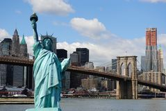Statue of Liberty and New York City Skyline. The landmark Statue of Liberty against the Brooklyn Bridge and the Manhattan skyline in New York City stock images