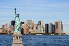 Statue of Liberty and New York City Skyline Stock Photos