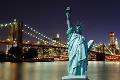 Statue of Liberty and New York City Skyline. The landmark Statue of Liberty against the impressive New York City skyline Royalty Free Stock Photo