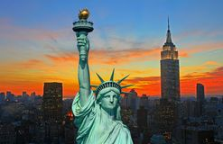 The Statue of Liberty and New York City skyline. At dark Royalty Free Stock Image