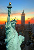 The Statue of Liberty and New York City skyline. At dark Royalty Free Stock Images