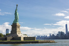 Statue of Liberty and the New York City Skyline. USA Royalty Free Stock Photos