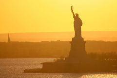 Statue of Liberty in New York City at sunset Royalty Free Stock Photo