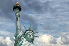 Statue of liberty in New York. Statue of liberty on cloudy sky background Stock Images