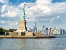 The Statue of Liberty with the New York skyline royalty free stock photography