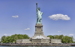 Statue Of Liberty. New York, USA - 22 May 2015. Tourists visiting an iconic sculpture on a sunny day of May. The Statue Of Liberty is a gift from the people of royalty free stock image