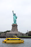 Statue of Liberty and a New York Yellow Water Taxi Stock Images