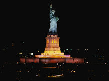 Statue of Liberty at night. This is the Statue of Liberty lit up at night on Liberty Weekend. It was taken from the Aircraft Carrier Kennedy stock images