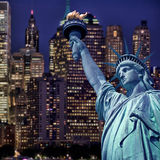 Statue of liberty by night, New York skyline. Background Royalty Free Stock Photo