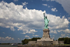 Statue of Liberty NYC. Groups of tourists visiting the Statue of Liberty and Liberty island on a summer day Stock Photos