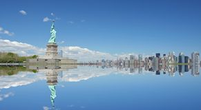 Statue of Liberty and NYC. Statue of Liberty and Manhattan skyline reflection Stock Photography