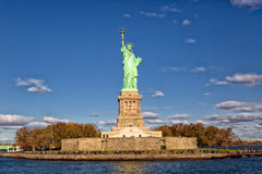 Statue of Liberty. Overseeing downtown Manhattan with One World Trade Center Royalty Free Stock Images