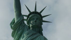 Statue of liberty with passing clouds stock video footage