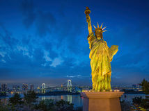 Statue of Liberty and Rainbow bridge, located at Odaiba Tokyo, w Royalty Free Stock Image