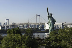 Statue of Liberty and Rainbow Bridge, Tokyo Royalty Free Stock Photo