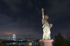 Statue of Liberty with Rainbow Bridge, Tokyo Tower and Tokyo Cit Royalty Free Stock Images