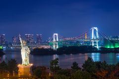 Statue of Liberty and Rainbow bridge in twilight at Odaiba Tokyo Stock Photo