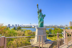 Statue of Liberty and Rainbow Bridge royalty free stock images