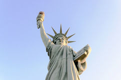 Statue Of Liberty Replica Isolated On Blue - Close Up Stock Images