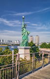 Statue of Liberty Replica near Rainbow Bridge in Odaiba, Tokyo. Statue of Liberty Replica near Rainbow Bridge in Odaiba Tokyo, Japan Royalty Free Stock Image
