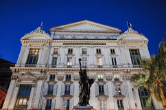 Statue of Liberty replica, Nice. NICE, FRANCE - NOVEMBER 19, 2014: Statue of Liberty replica with Opera Theatre Stock Photography