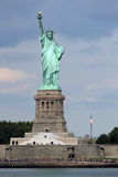 Statue of Liberty sculpture, on Liberty Island in the middle of. The Statue of Liberty (Liberty Enlightening the World), a colossal neoclassical sculpture on stock photos
