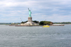 Statue of Liberty sculpture, on Liberty Island in the middle of. The Statue of Liberty (Liberty Enlightening the World), a colossal neoclassical sculpture on stock images