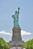 Statue of Liberty seen from Behind with blue sky background Royalty Free Stock Photography
