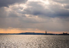 Statue of Liberty silhouette and Liberty Island - New York, USA Stock Photos