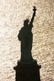 Statue of Liberty silhouetted. Aerial view of Statue of Liberty silhouette royalty free stock photo