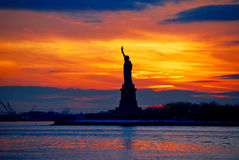 The Statue of Liberty. Silhouetted by sunset in New York, USA Stock Photos