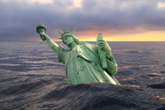 Statue of Liberty sinking in the ocean Stock Images