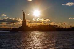Statue of liberty and sun. Royalty Free Stock Photo