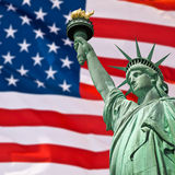 Statue of Liberty, sunny sky and USA flag Royalty Free Stock Photo